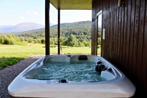 Stylish arty hot tub wooden chalet studio cabin with mountain views